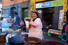 Woman preparing buñuelos, La Paz , Bolivia