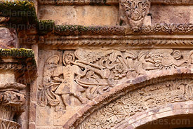 Detail of carving of angel playing trumpet above main side entrance of St John the Baptist of Letrán / San Juan Bautista de Letrán church, Juli, Puno Region, Peru