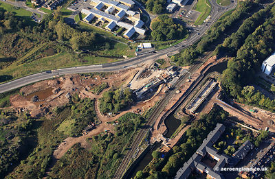 aerial photograph showing construction of the new Railway Bridge and canal aqueduct  over the A38 in  Birmingham England UK