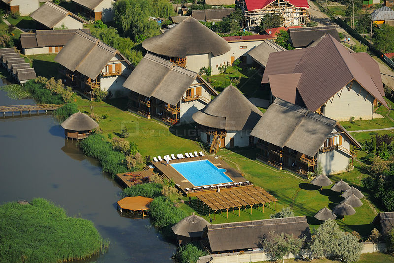 Aerial over Green Village lodge, Sfinthu Gheorghe, within the Danube delta rewilding area, Romania June 2012