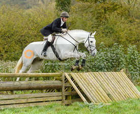 James Turcan jumping the hunt jump at Peakes Covert