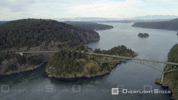 Aerial film of Pacific Northwest famous bridge with Washington mountains in background. Deception Pass Washington USA