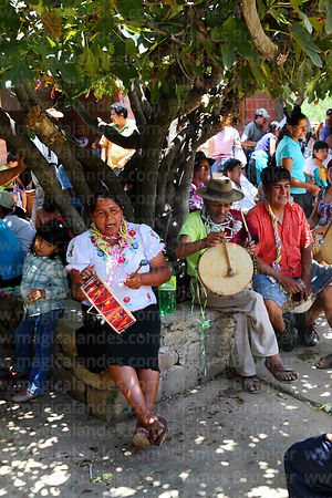 Woman playing caja (drum) and singing, Canasmoro, Tarija Department, Bolivia