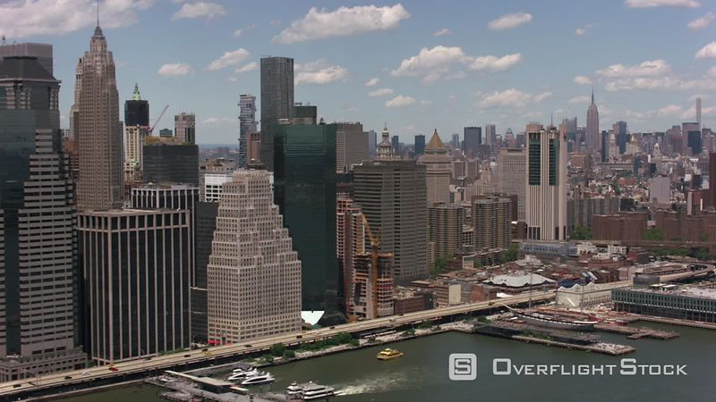 New York City, New York Flying up East River by Brooklyn Bridge.  Shot with Cineflex and RED EpicW Helium.