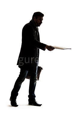 A silhouette of a mystery man in a big coat, handing over some documents – shot from mid level.
