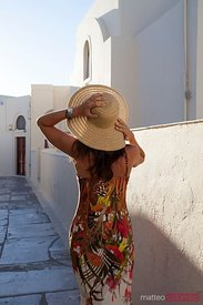 Woman walking in a small village street, Greece