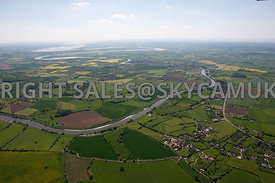 River Severn aerial photograph showing a high level wide angle view of the meandering course of the River Severn looking from the village of Minsterworth down the course of the Severn river