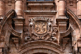 Coat of arms on entrance facade of San Pedro church, Cusco, Peru