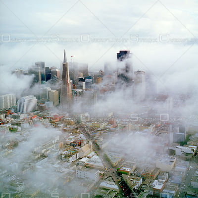 Dowtown San Francisco Skyline with Transamerica Pyramid in Fog. California.