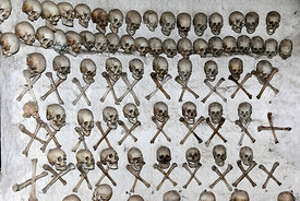Skulls and leg bones hanging on wall inside tomb of Enrique Torres Belón, church of Santiago the Apostle / Immaculate Conception, Lampa, Peru