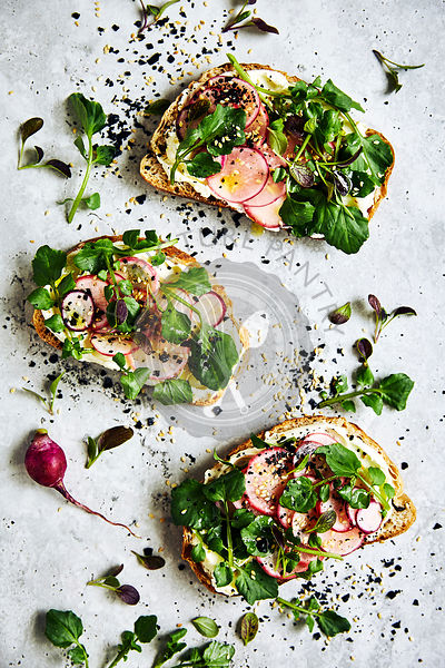 raddish, watercress and cream cheese open sandwich.