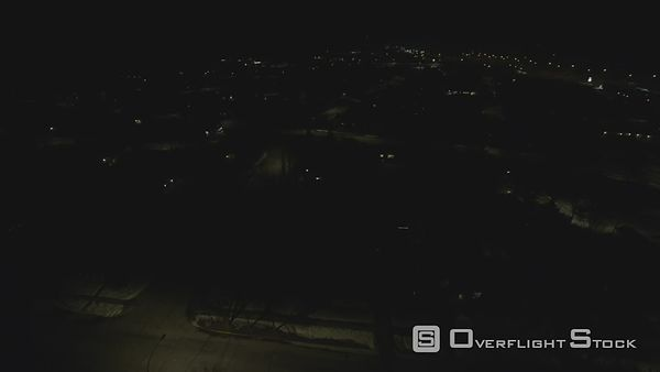 Night time low flight over the suburbs of Calgary Alberta