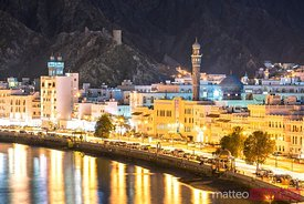 Oman, Muscat. Cityscape of Mutrah old town at dusk