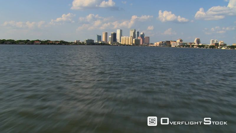 Low flight over water approaching downtown Tampa, Florida