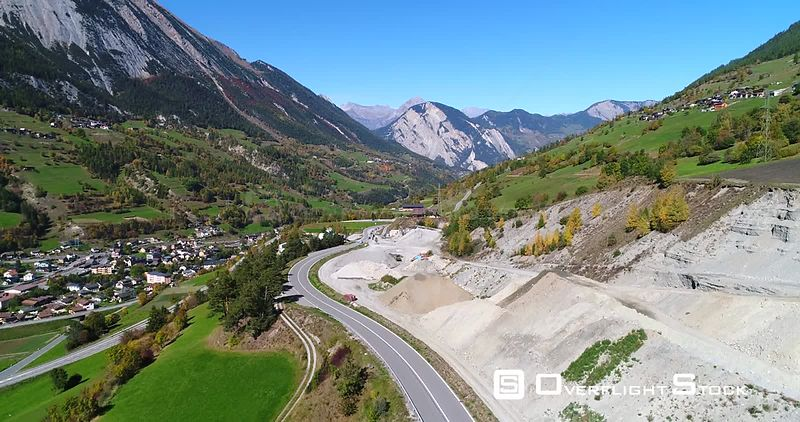 Alpine Landscape, 4k Rising View of a Town, Snowy Mountains and Colorful Fall Trees, Sunny Autumn October Day, Near Grand San Bernard Pass, Switzerland