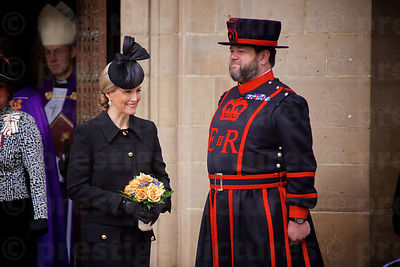 Sophie Countess of Wessex Smiling as she walks past a Yeomen Warder of the Tower of London (Beefeater).