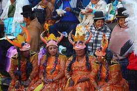 China Supay / female devil diablada dancers take a break from dancing during the Gran Poder festival, La Paz, Bolivia