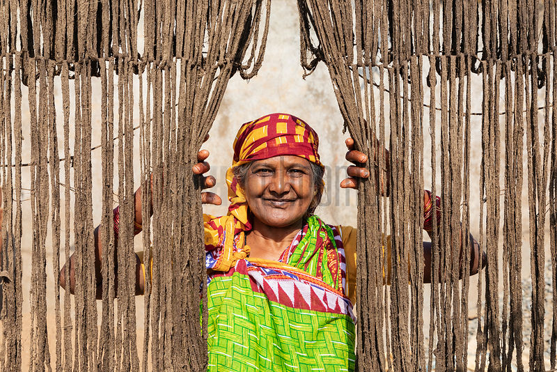 Portrait of a Woman Hanging Freshly Treated Cotton for the Weaving Process