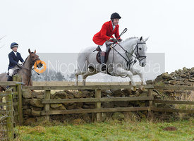 Tom Kingston jumping a wall at Goadby Hall