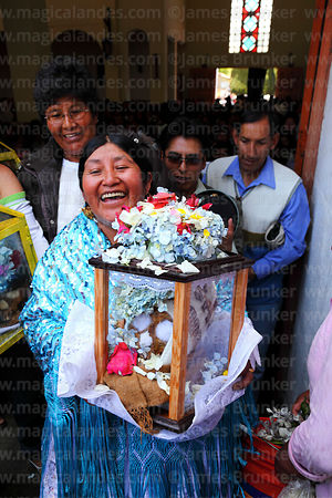 Aymara woman leaving church with her skull after mass, Ñatitas festival, La Paz, Bolivia