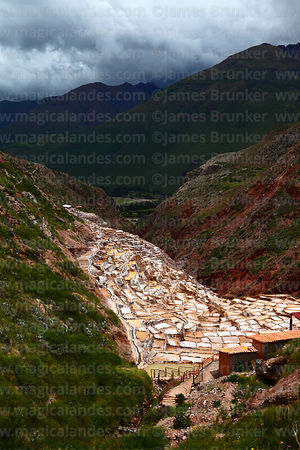 View over salt evaporation terraces at Las Salineras to Urubamba Valley, Maras, near Cusco, Peru