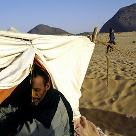 A nomad in his tent in the desert between the cities of Chinguetti and Choum. The nomads are the link between the cities and the wind - trading on the same routes over millennia