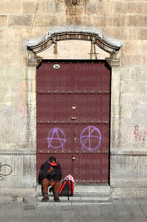 Anarchy symbol graffiti on San Francisco convent door, La Paz, Bolivia