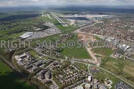 Manchester Airport view of developments taking place at the end of the runway, Moss Nook, Styal Road, Ringway Road with Manchester Airport in the background