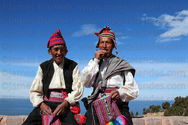 Men chewing coca leaves (kept in a woven bag called a chuspa), Taquile Island, Peru