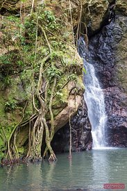 Waterfall and rock looking like a human face, Fiji