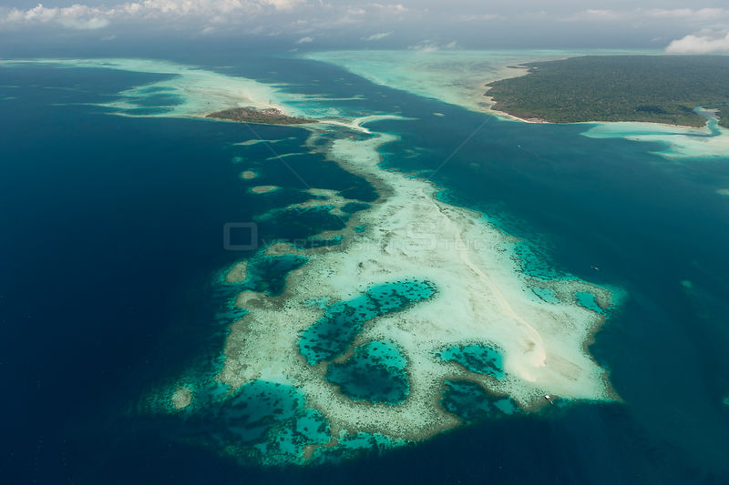 Aerial view of coral cays and white sand bars surrounding Bugsuk Island, Farm 1 of Jewelmer pearl farm.