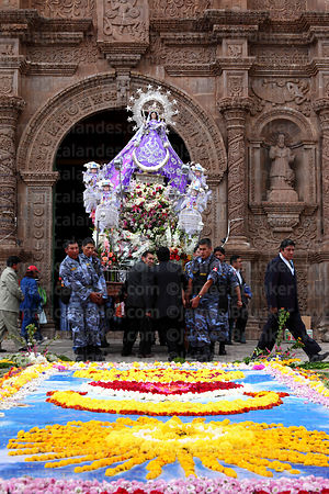 Serenazgo security police carry the Virgen de la Candelaria out of the cathedral before the central mass, Puno, Peru