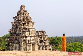 Buddhist monk looking at view near temple, Angkor, Cambodia