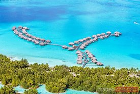 Aerial of overwater bungalows of Four Seasons resort, Bora Bora, French Polynesia