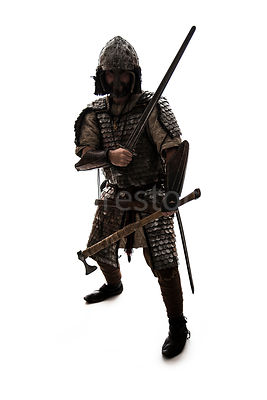 A semi-silhouette of a wealthy Viking in armour – shot from eye level.