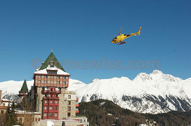 Helicopter of Helibernina over Badrutt's Palace Hotel in Saint St. Moritz