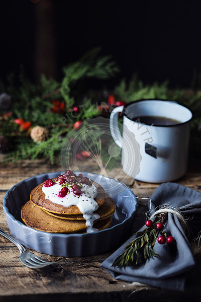 Christmas breakfast table: pumpkin pancakes with yogurt cream and currant