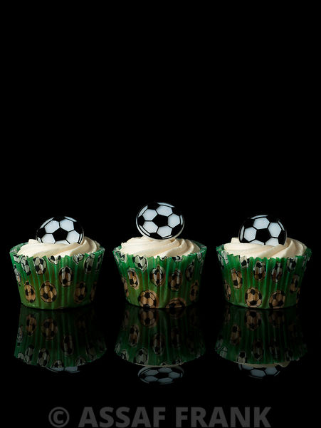 Cupcakes with football shaped decoration
