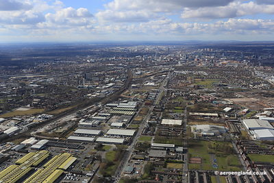 aerial photograph of Openshaw  East Manchester looking towards the city centre along Ashton Old Road, Manchester M11 2NA