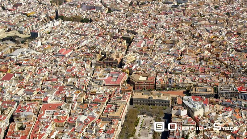AERIAL VIEW OF THE HISTORIC CENTER OF SEVILLE WITH  IN ORDER OF APPEARANCE  PLAZA NUEVA, CATHEDRAL AND GIRALDA BELFRY, ARCHIVOS DE LAS INDIAS, MAESTRANZA BULLRING, MEASTRANZA THEATER AND TORRE DE ORO SPAIN