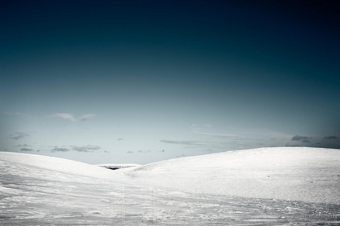Wide snow landscape with hills