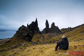Hiker looking at Old man of Storr isle of Skye Scotland UK