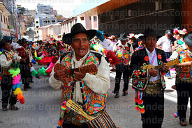 Musicians with Qaswas los Cinco Claveles dance group from Capachica playing round charangos, Virgen de la Candelaria festival, Puno, Peru