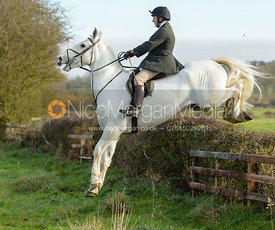 Albany Mulholland jumping a hedge on Deane Bank