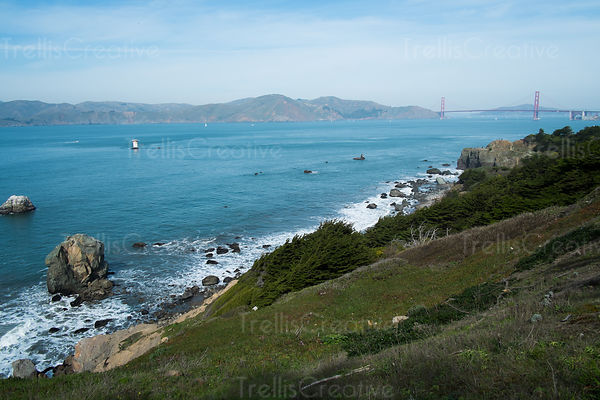 A scenic view of the Golden Gate bridge from the bayside cliffs