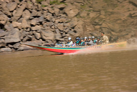 Laos - A speed boat on the mekong river.