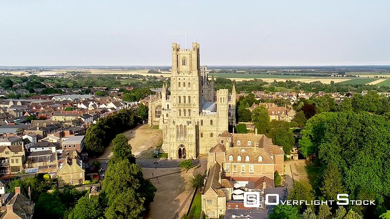 Aerial view of Ely Cathedral, The Old Palace, Minster Place, zooming out, filmed by drone in summer, United Kingdom