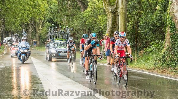 Group of Cyclists in a Rainy Day