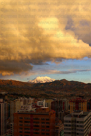Dramatic storm clouds over La Paz and Mt Illimani at sunset during rainy season , Bolivia