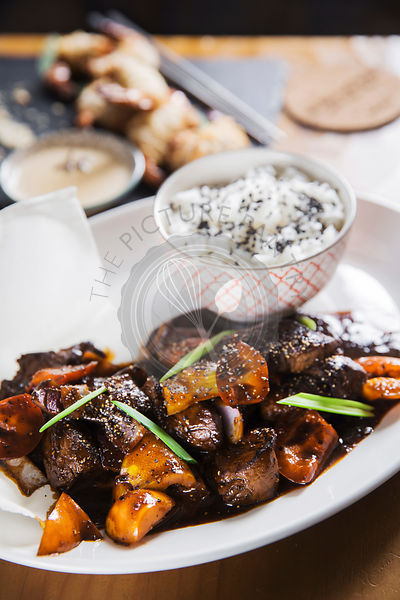 Asian dish - beef in black pepper sauce with vegetables and rice